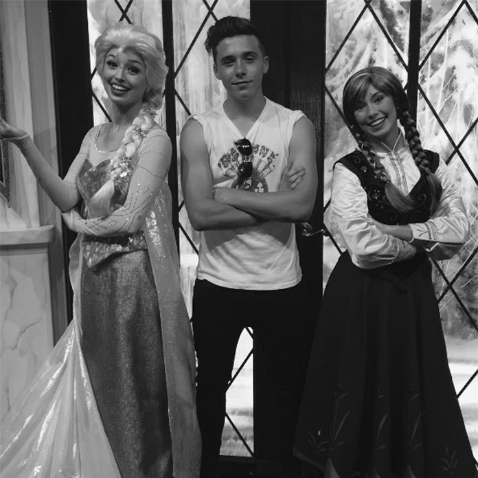 Brooklyn Beckham proved to be the ultimate ladies man while visiting Disneyland – he couldn't resist posing for a picture with Elsa and Anna.