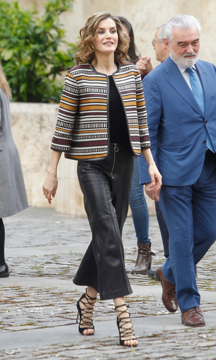 The Queen of Spain looked rocker chic in May sporting black leather culottes by Uterque and a colorful striped jacket by the same brand to the opening of the 2016 International Seminar on Language and Journalism in San Millan de la Cogolla, Spain.