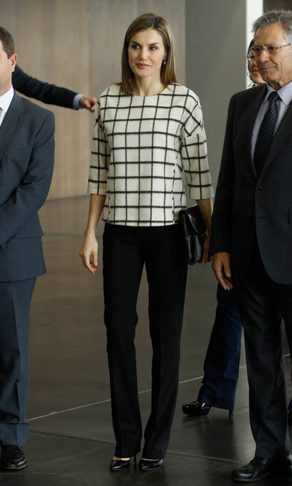 The Spanish royal was effortlessly stylish at the Commemoration of the World Day of Red Cross and Red Crescent wearing her signature black BOSS trousers and a checkered print top by Danish label Designers Remix in May 2016.