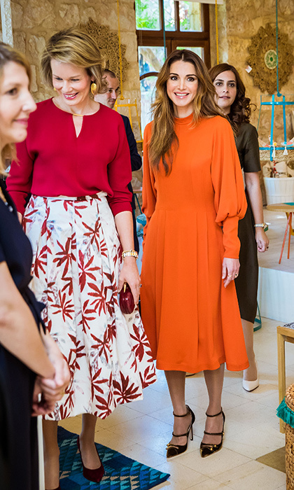 Queen Rania and Queen Mathilde of Belgium both opted for fall colors for their meet up in Jordan.