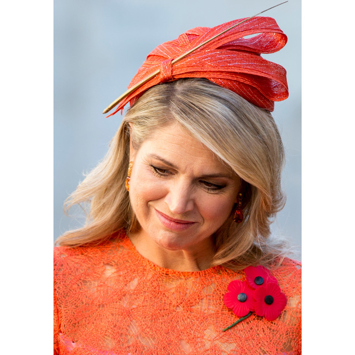 Maxima complemented her lace frock and poppy brooch with a tangerine hat, which featured an accent pin, for her visit to the War Memorial in Canberra, Australia.