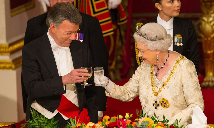 Cheers! Queen Elizabeth welcomed Colombian President Juan Manuel Santos to Buckingham Palace with a State Banquet.