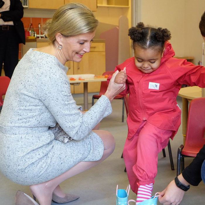 Sophie Wessex gave a young girl a hand putting on shoes, during her visit to Cathnor Park Children's Centre, which provides care and education for families.