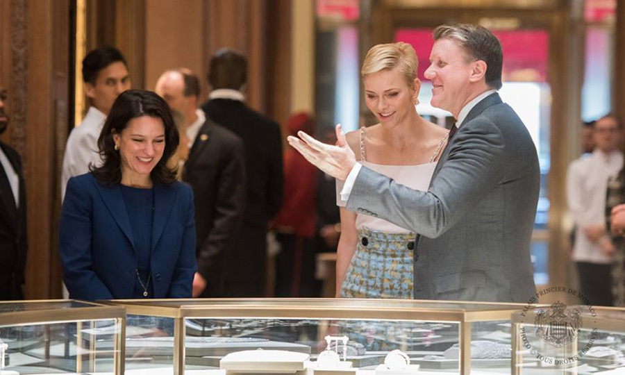 Princess Charlene looked elegant in a rose top and high-waisted skirt as she toured the headquarters of the Maison Cartier.
