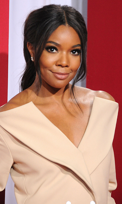 Her bangs softly framing her face, <b>Gabrielle Union</B> rocked flawless skin with natural lips for the premiere of Universal's <i>Almost Christmas</I> in Westwood, California. 