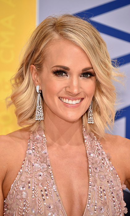 <B>Carrie Underwood</b> was all Hollywood glamour with sleek brows and dramatic eyes for the 50th annual CMA Awards in Nashville. 