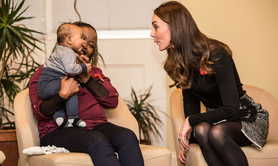 It was an adorable royal stare-off for the Duchess of Cambridge and four-month-old Gabriel at the Nelson Trust Women's Centre in Gloucester. Kate made a silly face with her new friend during her visit to the center, which helps support women.