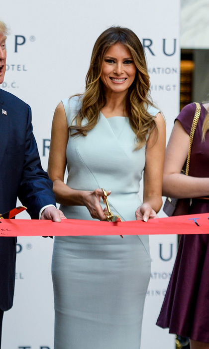 The First lady-elect looked anything but blue in a form-fitting dress at the ribbon cutting ceremony at the Trump International Hotel in Washington, D.C. 