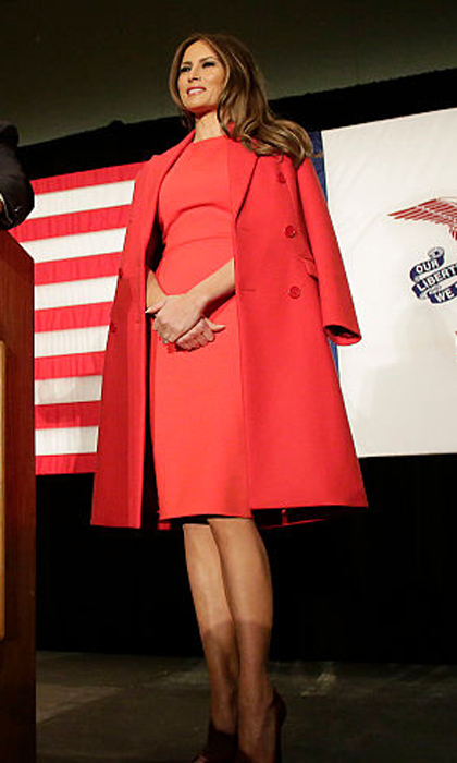 Melania was the lady in red wearing a red sheath dress and matching coat as she listened to her husband speak at a campaign event at the US Cellular Convention Center in Cedar Rapids, Iowa. 