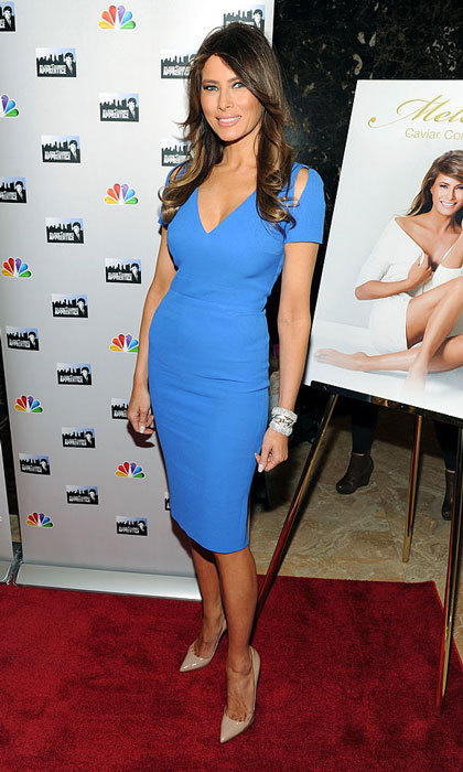Blue beauty. Donald's wife stunned in a figure hugging blue dress with shoulder cutouts at a 2013 <i>Celebrity Apprentice All-Star</i> event in New York City. 