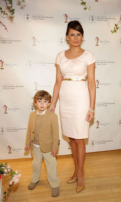Melania was pretty in pink and pearls at FAO Schwartz's annual Bunny Hop in 2009 with her young son Barron.