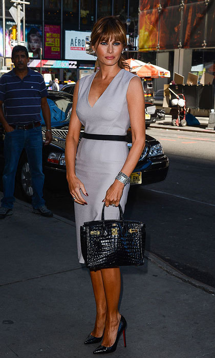 Fifty shades of chic! Donald's wife visited the ABC Times Square Studios in New York wearing a classic grey sheath dress and Christian Louboutins.