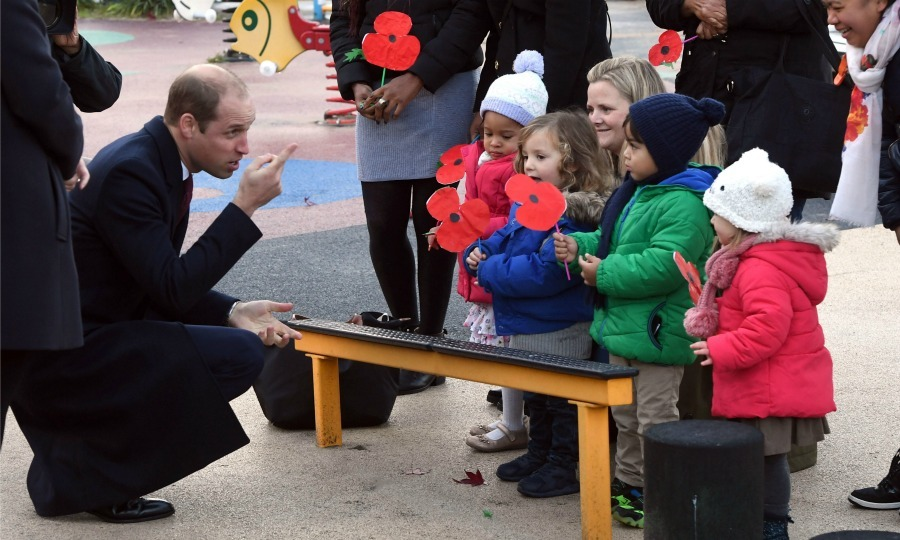 Little poppies! William did his traditional kneel as he spoke to a few little visitors at the Kensington Memorial Park. 