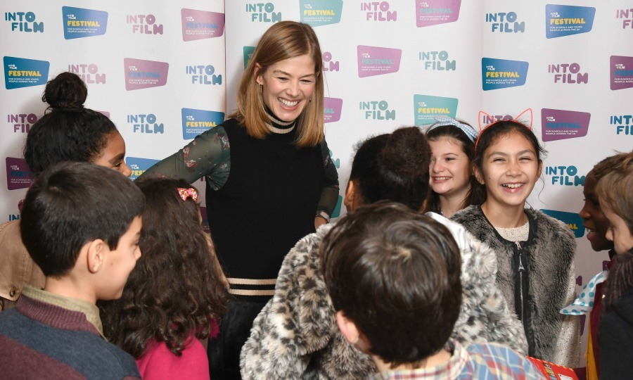 November 9: Rosamund Pike had some fun with the kids during the kick off of the Into Film Festival at Vue West End in London. 