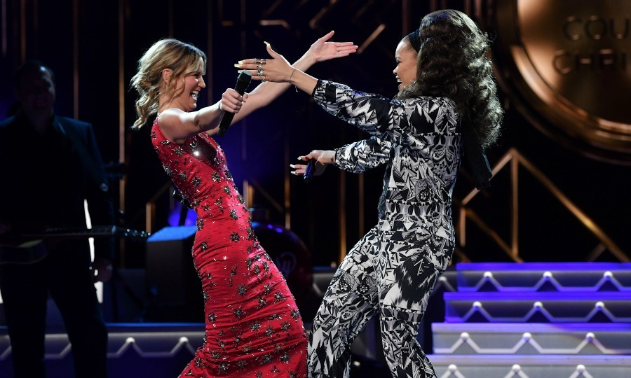 November 8: Jennifer Nettles and Andra Day hugged it out after their performance during the CMA 2016 Country Christmas taping in Nashville. 