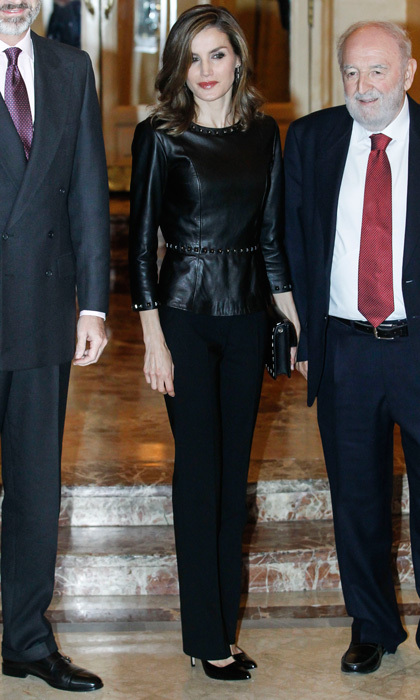 Queen Letizia looked sharp in an all-black ensemble paired with a bold red lip on November 10. The Spanish monarch stepped out to the 33rd Francisco Cerecedo Journalist Awards ceremony in Madrid wearing her signature BOSS trousers and an edgy leather top by Uterque. 