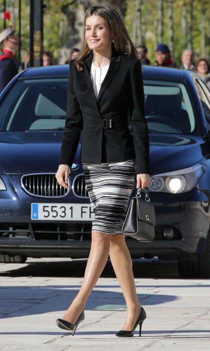 Business chic! Queen Letizia stepped out wearing a BOSS blazer and BOSS scribble-print skirt for the International Symposium on Carlos III.  