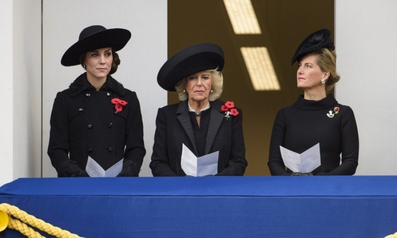 Duchesses Kate and Camilla and the Countess of Wessex joined their husbands during the Sunday outing in similar black coats with poppy pins.