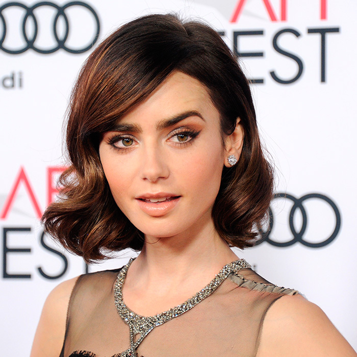 "<a href=""http://us.hellomagazine.com/tags/1/lily-collins/""><strong>Lily Collins</strong></a> channeled 1960s glamour with soft brown tones and a perfect cat eye flick at the Premiere of 20th Century Fox's <I>Rules Don't Apply</I> in Hollywood, CA.