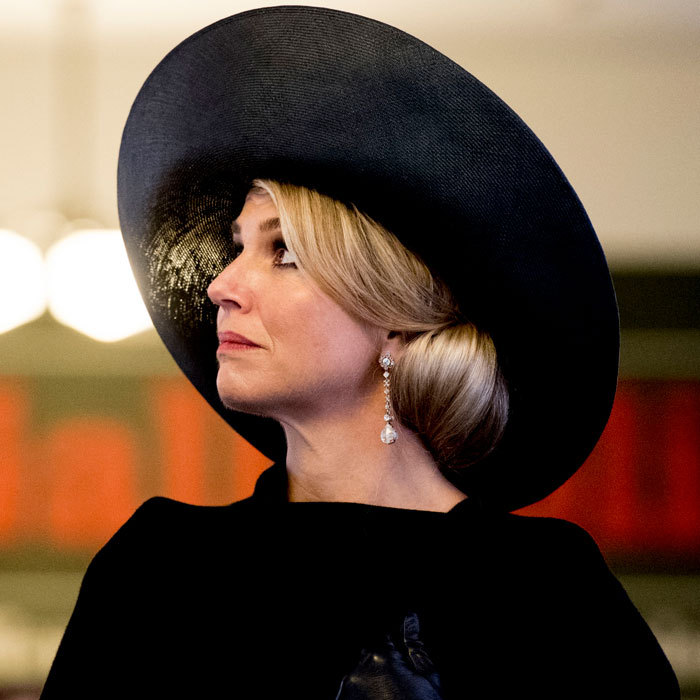 Queen Maxima paired her elegant side-chignon with a dramatic black hat for her outing to the tomb of the Unknown Warrior at the Pukeahu National War Memorial Park in Wellington, New Zealand.