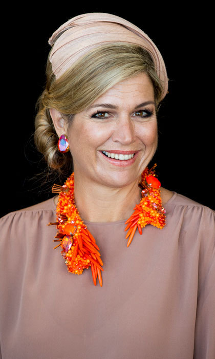 Maxima looked pretty in pink pairing her dusty rose-colored blouse with a matching, sophisticated fascinator for a meeting at the Crystal Palace in Luna Park in Sydney, Australia.
