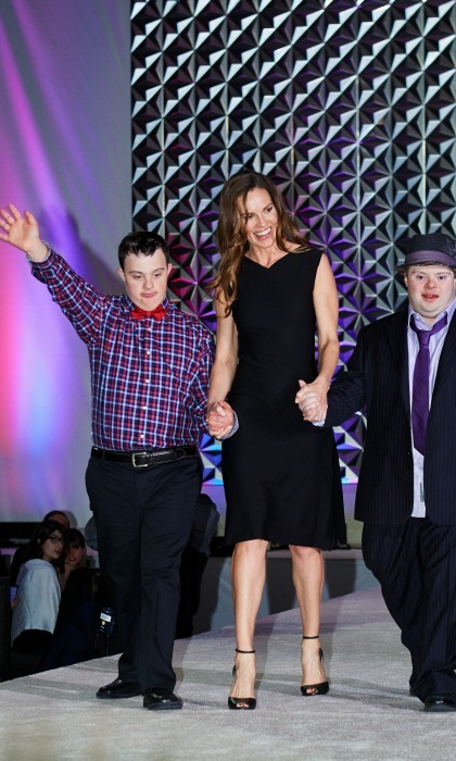 November 12: Hilary Swank was escorted down the runway by two special guests during the 2016 Be Beautiful, Be Yourself Fashion Show in Denver.  