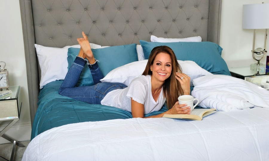 November 10: Brooke Burke-Charvet relaxed on her new comfortable and luxurious Hotel Style bedding by Walmart that she uses in her home in Malibu. 