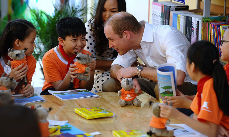 Prince William joined a class of eight-years-olds in the library of Hong Ha Primary school. The Duke used the opportunity to discuss protecting wildlife with the children who were being read the storybook <i>I'm a Little Rhino</i>.
