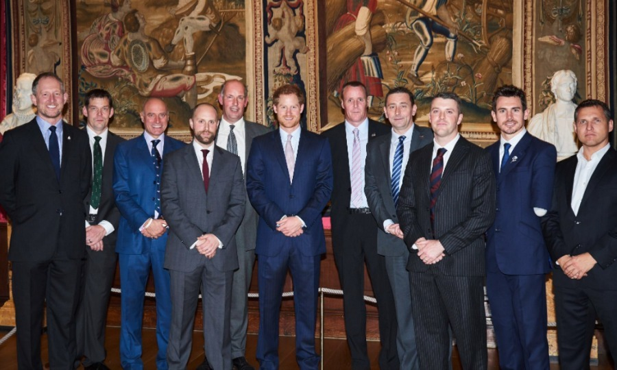 Prince Harry attended the Walking with the Wounded ceremony at Kensington Palace, where he chatted with ex servicemen and women who took part in the charity walk, which is dedicated to re-training wounded warriors. 