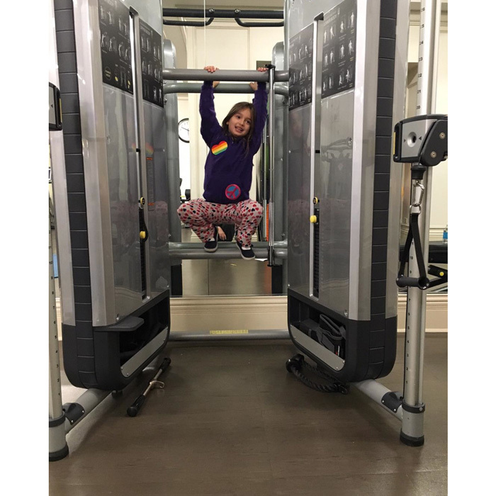 "The mom-of-three had a special workout buddy for her Friday gym session. Attached to a picture of her daughter Arabella hanging on to exercise equipment, she wrote, ""Monkeying around with my gym buddy. #FitnessFriday"".