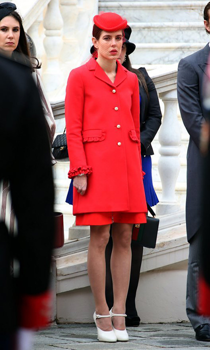 Charlotte Casriaghi looked characteristically chic in a red ruffle-trimmed coat and matching hat with veil for Monaco's National Day.