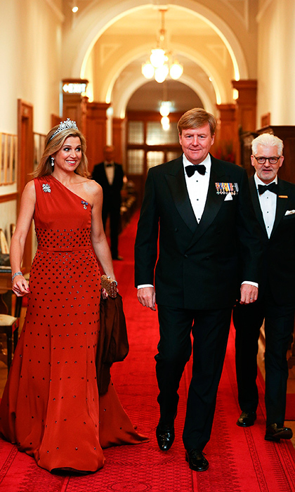 Queen Maxima of the Netherlands stunned in a red embellished Claes Iversen couture gown for a state dinner at Government House on November 7, 2016 in Wellington, New Zealand. 