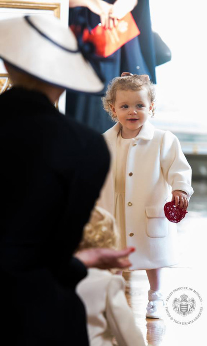 Princess Gabriella looked angelic, in her white Armani Junior ensemble as she played with her mother.