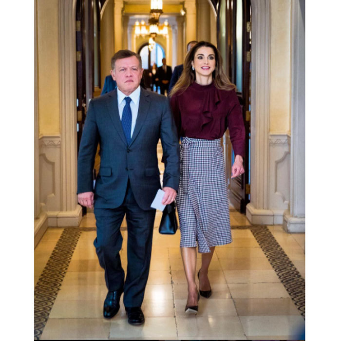 Queen Rania looked effortlessly chic in a high-waist skirt and burgundy blouse as she joined her husband King  Abdullah at a meeting on vocational training and human resources development.