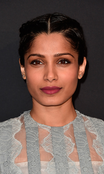Actress Freida Pinto sported a dark lip for the Prada Presents <I>Past Forward</I> by David O. Russell premiere in Los Angeles on November 15. 