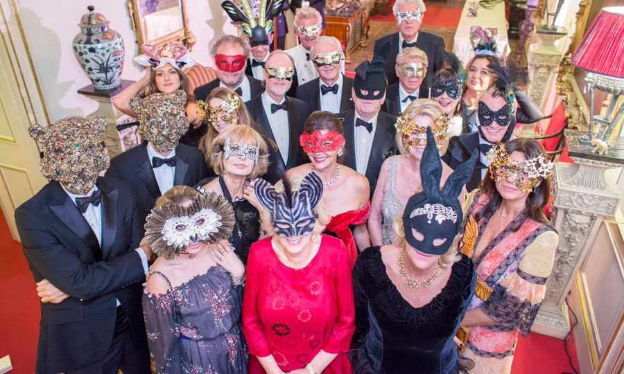 Things got <i>wild</I> for the Duchess of Cornwall (in red)! Prince Charles' wife donned an animal mask alongside supporters of the Elephant Family organization at the charity's Animal Ball.