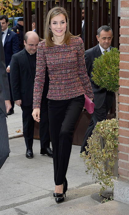 Queen Letizia, wore her go-to BOSS by Hugo Boss trousers and a bouclé top for her visit episcopal conference building in Madrid, Spain on November 22.