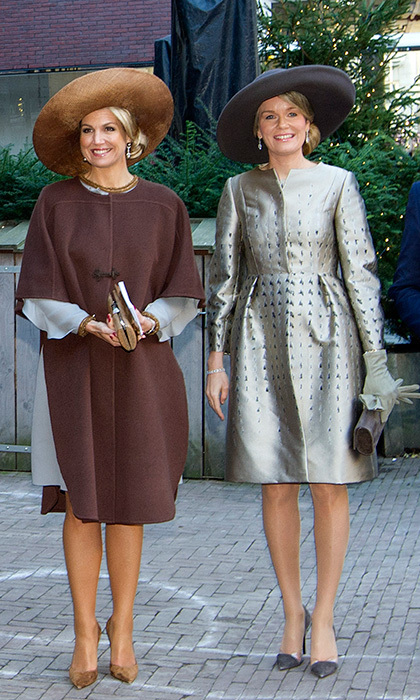 Queen Maxima, left, and Queen Mathilde were also in sartorial step in chic coats on November 28 as they visited the Flemish culture house de Brakke Grond in Amsterdam, during the King and Queen of Belgium's 3-day state visit to the Netherlands. 