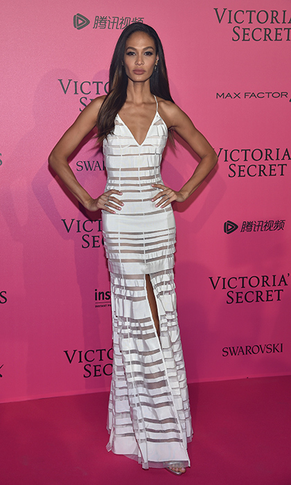 November 30: Joan Smalls showed off her toned figure in a white gown with sheer cut outs for the 2016 Victoria's Secret Fashion Show after party in Paris. 