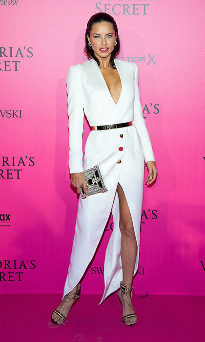 November 30: Wearing a tailored white dress, veteran Angel Adriana Lima turned heads at the 2016 Victoria's Secret Fashion Show after party in Paris. 