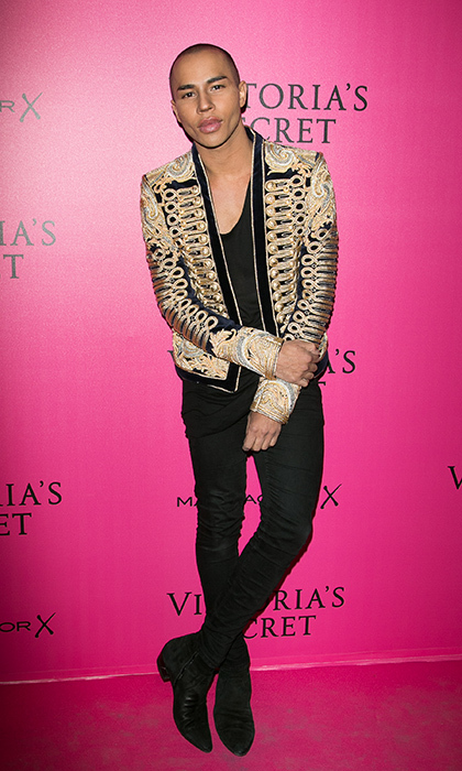 November 30: Balmain designer Olivier Rousteing donned one of his own pieces – a gold Balmain jacket – for the 2016 Victoria's Secret Fashion Show pink carpet in Paris.