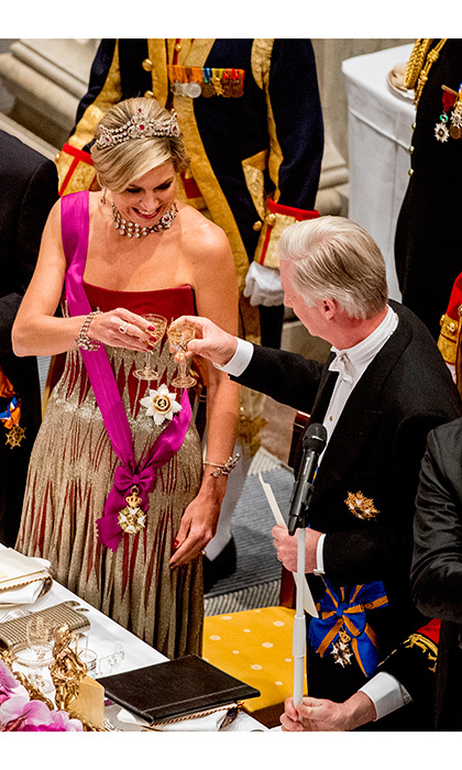Cheers! King Philippe and Queen Maxima raised their glasses to each other at a state banquet held at the royal palace in Amsterdam.