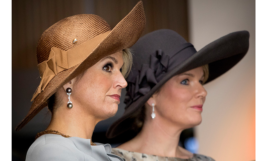 The Queens opted for statement hats for their visit to the Flemish culture house de Brakke Grond in Amsterdam, where they viewed a photo exhibition named Euregio-Maas-Rijn.