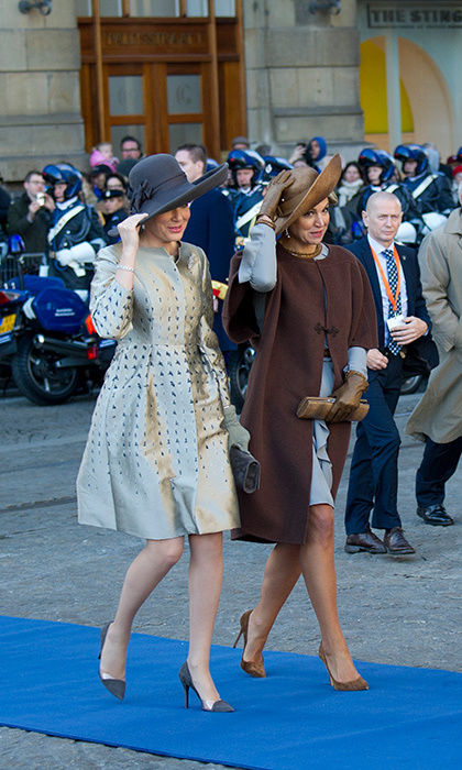 Twinning royals! Not only were Mathilde and Maxima sporting similar ensembles at the Belgian royals' welcoming ceremony, but also similar mannerisms.