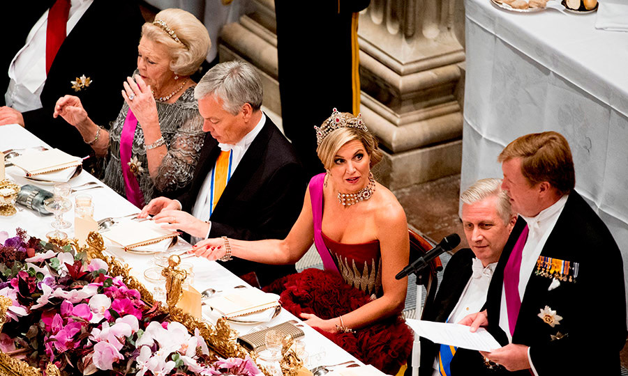 Queen Maxima attentively watched her husband King Willem-Alexander speak at a state banquet held at the royal palace in Amsterdam.