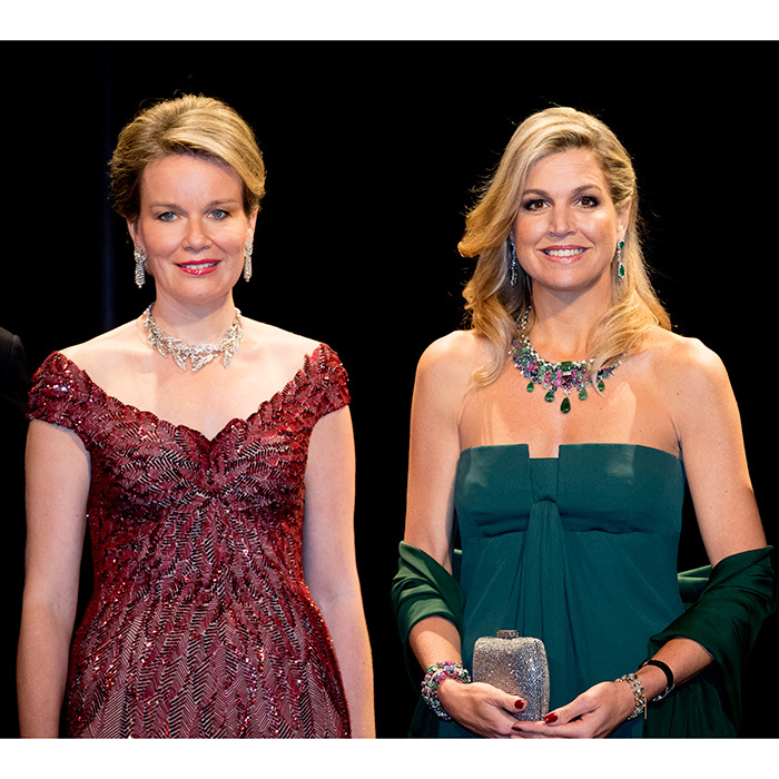 The Queens (Mathilde, left, and Maxima, right) looked regal in gowns and dazzling jewels at a concert held at the concert hall, Muziekgebouw Aan't IJ.
