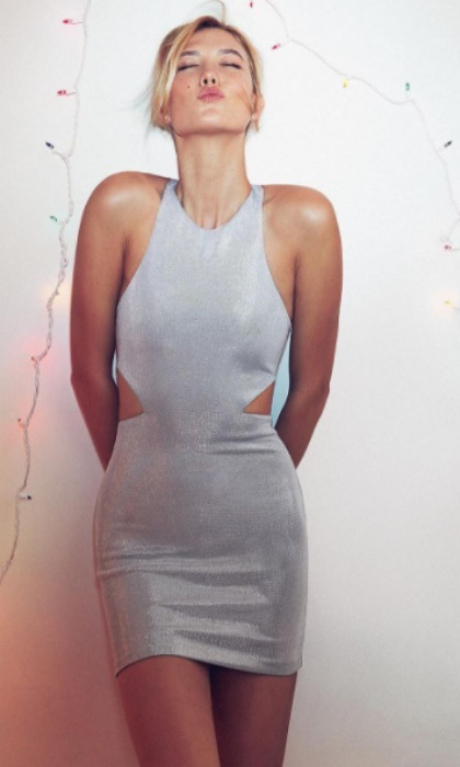 "<a href=""http://us.hellomagazine.com/tags/1/karlie-kloss/""><strong>Karlie Kloss</strong></a> was ""feeling festive"" in a silver holiday dress, posing alongside Christmas lights.