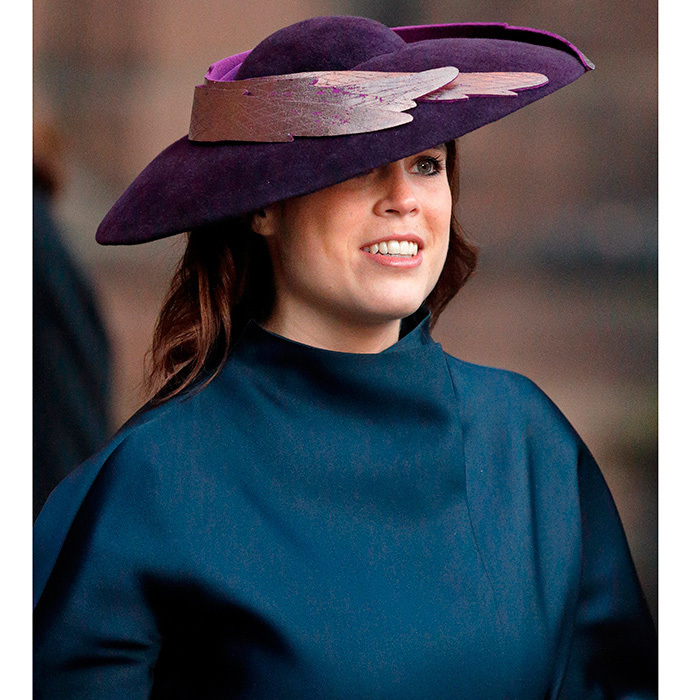 Princess Eugenie chose a striking winged hat and jewel tones for a memorial service honoring the 6th Duke of Westminster at England's Chester Cathedral. The Duke died at the age of 64 in August.