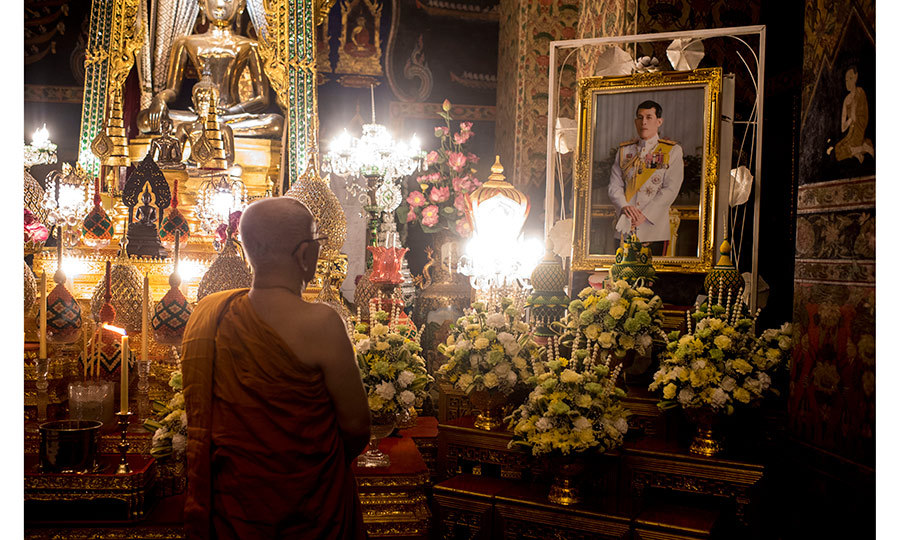 A monk prays in front of the portrait of Thailand's new King in Bangkok. Crown Prince Maha Vajiralongkorn was proclaimed monarch on December 1, 50 days after the death of his father, King Bhumibol Adulyadej. 