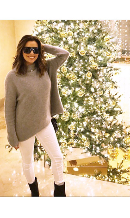 "So bright she had to wear shades! <a href=""http://us.hellomagazine.com/tags/1/eva-longoria/""><strong>Eva Longoria</strong></a> posted this picture  of herself and an equally glam Christmas tree.